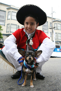 Gabriel Enriquez 10 years with his Chihuahua names Spikey 1 year old of group Aquarela, pose for the camera as they wait their turn to perform in the parade.  The San Francisco Carnival is a parade that celebrates the cultural diversity from around the world that comes together in our unique bay area environment. This yearÕs Carnival featured 80 different dance contingents several of which included decorated floats.  The Parade dances through Mission District Streets.  Afterwards there is a street fair with food, music and further Dance Performances.  Special to the Examiner.
