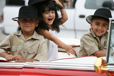 "Members of the ""Viejitos Car Club"" in San Jose, Anthony Gonzales age 7, Veronica Gonzales age 3, and Peter Gonzales age 5, all of San Jose, clown around in a classic convertable car before the parade begins.  The San Francisco Carnival is a parade that celebrates the cultural diversity from around the world that comes together in our unique bay area environment. This yearÕs Carnival featured 80 different dance contingents several of which included decorated floats.  The Parade dances through Mission District Streets.  Afterwards there is a street fair with food, music and further Dance Performances.  Special to the Examiner."