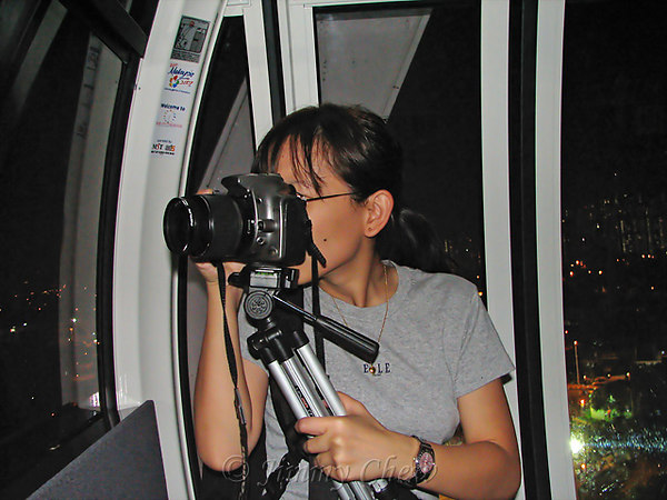"""<font color=""""yellow"""">Joyce couldn't live without the tripod.</font><br>"""