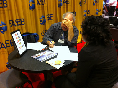 Dr. Andrew Green conducts a resume critique for an undergraduate student at ABRCMS 2011.