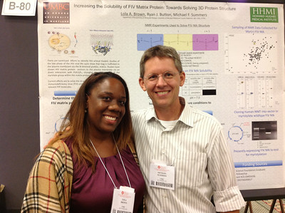 PhD student, Lola Brown of the University of Maryland Baltimore County poses with her mentor, Dr. Michael Summers during the 26th Annual Symposium of The Protein Society in San Diego.