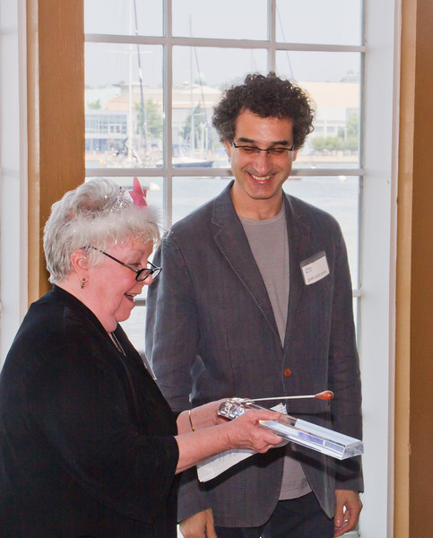 ASO Music Director Jose-Luis Novo presents a baton to Judi Tanner, outgoing FASO President of the Board