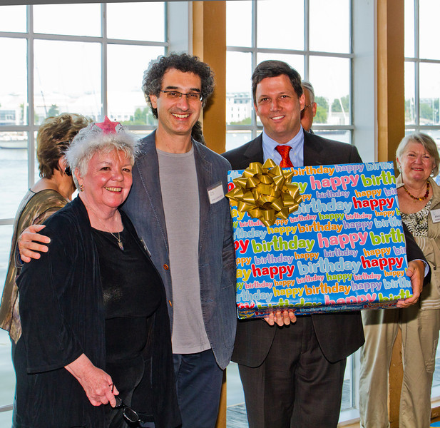 """Jose-Luis Novo, Music Director, ASO and John Goldthwait, Chairman of the Board, receive a 50th Symphony birthday present of five """"K""""s that represent a $5,000 grant to the ASO from Judi Tanner, outgoing President, FASO"""
