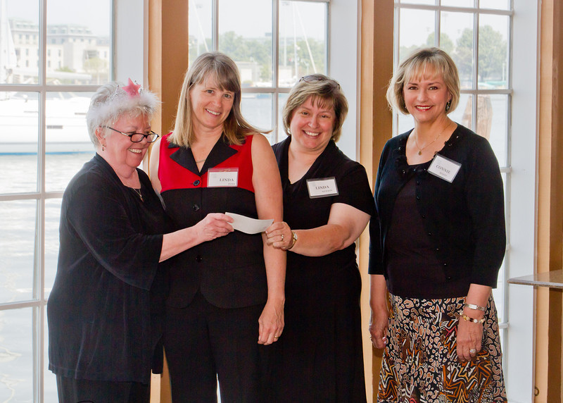 Judi Tanner, outgoing President (left), and Connie Smith (right), FASO, present a $1500 scholarship award for a Chesapeake Youth Symphony Orchestra student to Linda Foss, Executive Director, and Linda Newsom, President of the Board, CYSO