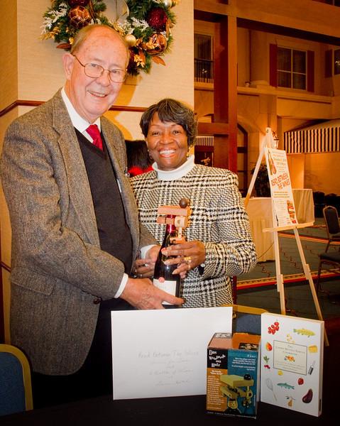 Ralph Reeder presents the prizes to the raffle winner, Tessie Ballard