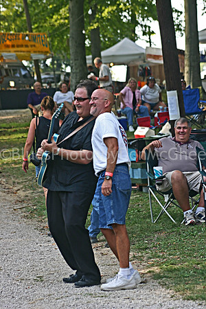 Bean Blossom 2004 guitar player and fan