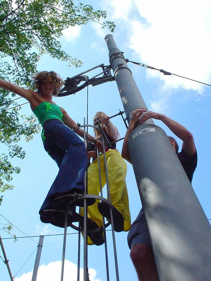 Marisca, Isabel and Sjoerd climb a tram pole