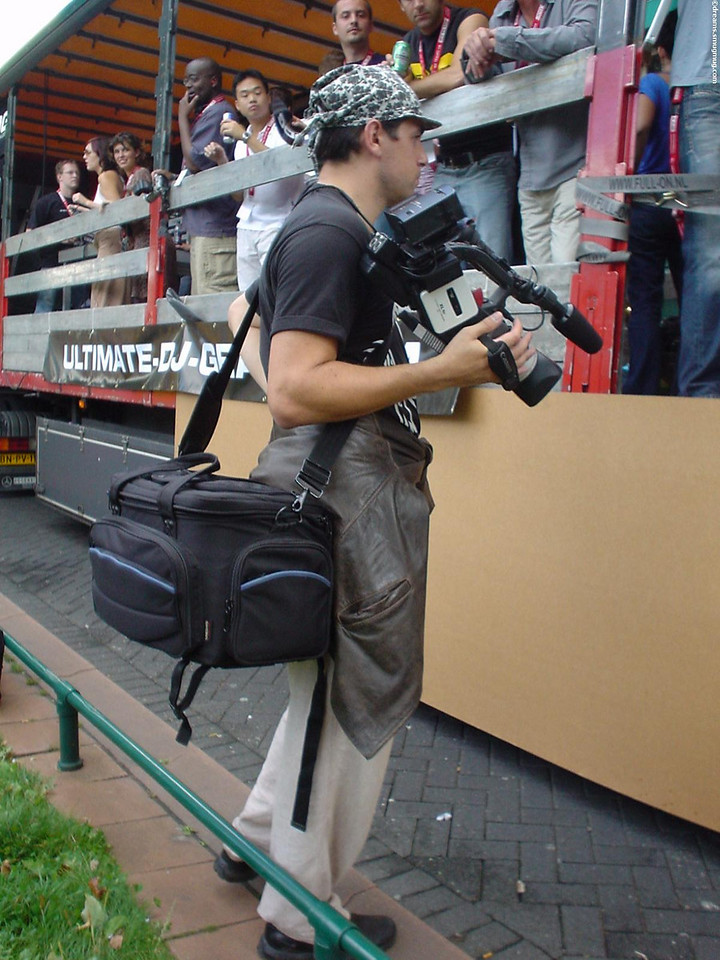 *Real* photographer and cameraman. Boy is he gonna be sore after lugging that around all day!