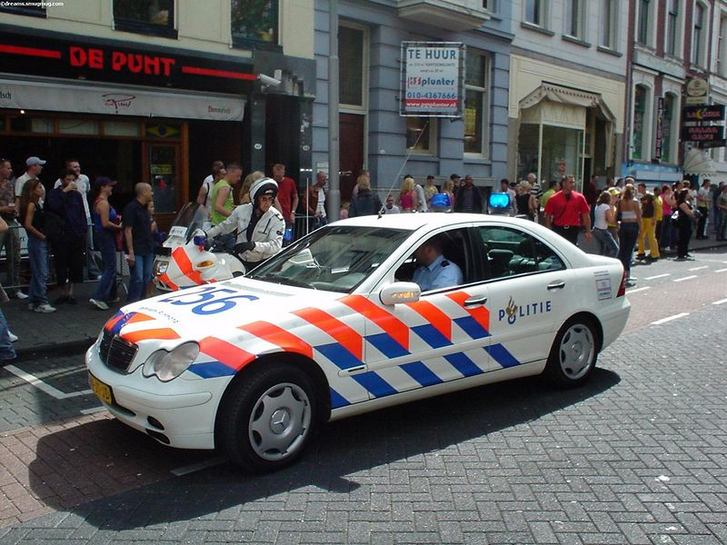"""Police car leading the front of the trucks of the <a href=""""http://www.ffwdheinekendanceparade.nl/"""">Dance Parade</a>"""