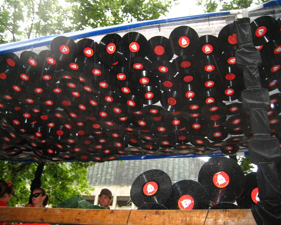 A Gazillion of old LP record stapled against the ceiling! Very cool idea!<br /> Notice the rain falling...?