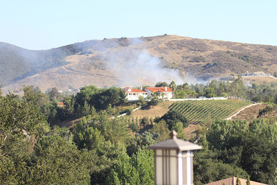 8/6/11 Plume of smoke erupted around 5:30pm across the hill beyond Avenida La Cresta, as seen from our back deck. Not sure of the cause, but this one was quickly snuffed out within an hour.