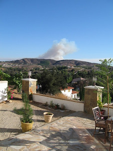 9/9/07 Deluz Fire, west of Temecula (as seen from our back patio). About 430 acres burned. The fire started when a stolen car crashed into a rock and caught fire on Carancho Road, a winding canyon road. The occupants of the car were uninjured and fled, according to the California Highway Patrol.