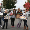 Julia, Lena, Olha, Rita, and Marbella arrive at the Humanitarian Center with boxes of donations