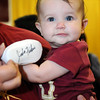 Liliana Delgado, 6 mos, poses with her signed Seminole shoe during FSU Fan Day held on August 14th at the Civic Center.