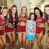 Sarah Beth Winton, 9, poses with some of the FSU Cheerleaders during FSU Fan Day held on August 14th at the Civic Center.