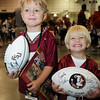 Carter Costin, 5, and Cade Costin, 3, pose with their signed footballs during FSU Fan Day held on August 14th at the Civic Center.