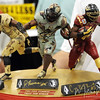 A fan shows off his signed statues during FSU Fan Day held on August 14th at the Civic Center.