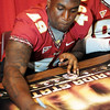 Brandon Jenkins signs a poster during FSU Fan Day held on August 14th at the Civic Center.