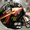 A fan shows off his signed helmet during FSU Fan Day held on August 14th at the Civic Center.