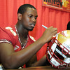 #88 Bo Reliford signs a helmet for a fan during FSU Fan Day held on August 14th at the Civic Center.