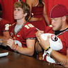 Dustin Hopkins and Shawn Powell sign memorabilia for their fans during FSU Fan Day held on August 14th at the Civic Center.
