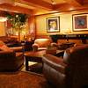 Brown Club Chairs, Coffee Tables, Area Rugs, Accent Tables, Plants, Accessories