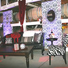 Black Leather, Zebra Chairs, Coffee Table, Illuminated Bar and Accents