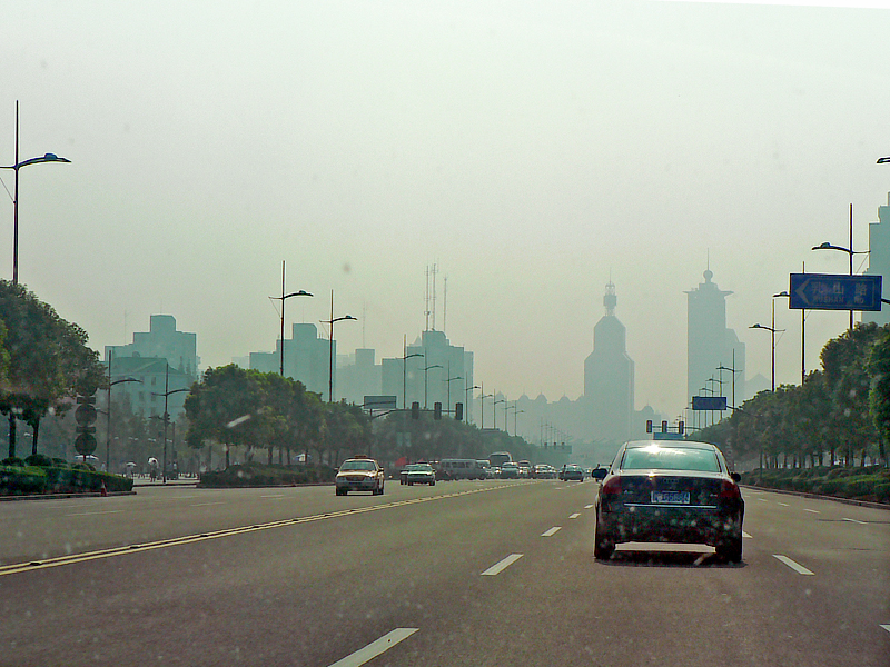 A Shanghai avenue from the windshield on the way to the factory.