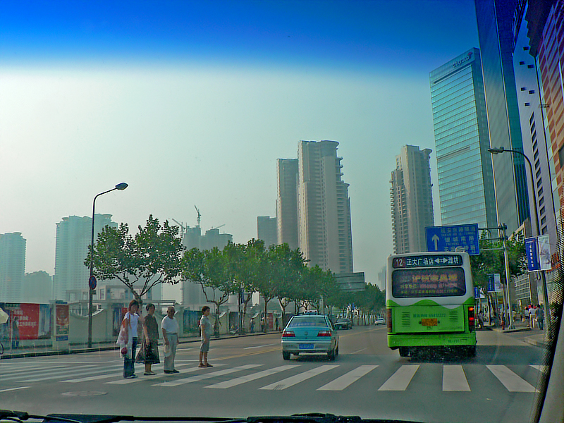 Shanghai street from the dirty windshield of the service car.