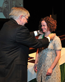 President Kopp (left) presents medal to Dr. Whitney Douglas, assistant professor of English, Pickens-Queen Excellence in Teaching Award