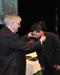 President Kopp (left) presents medal to Dr. Shawn Schulenberg, assistant professor of political science, Distinguished Artists and Scholars Award, junior recipient among all faculty