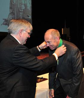 President Kopp (left) presents medal to Dr. Michael Householder, associate professor of English, Pickens-Queen Excellence in Teaching Award