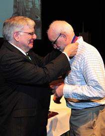 President Kopp (left) presents medal to Dr. Dan Holbrook, associate professor of history, Charles E. Hedrick Outstanding Faculty Award