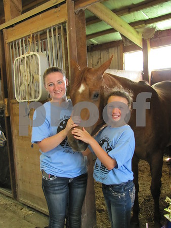 "Jenna Sankey with her horse ""Retail Therapy"", and Emma Woltman."