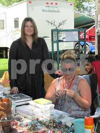 Melissa Rhymer and Heather Mall at Mall's jewelry booth on the fairgrounds.