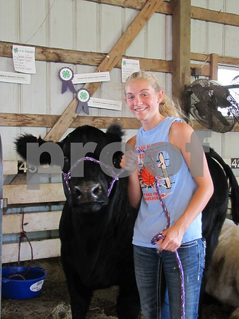 "Jaynie Ferrari and her cow ""Cocoa"""