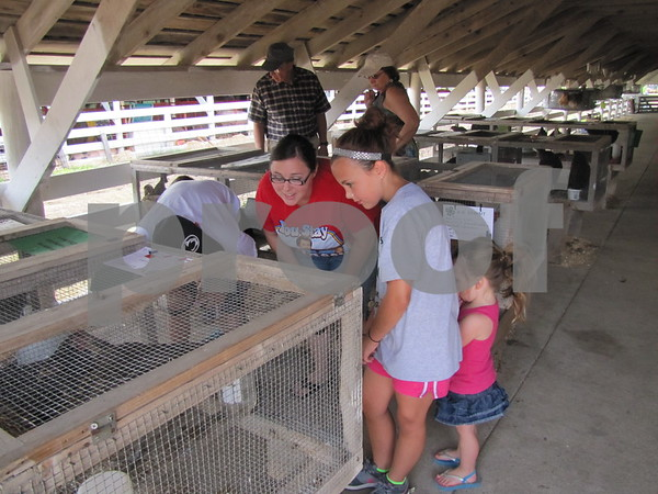 Delayna Lawman and her daughter Adalynn checking out the chickens.