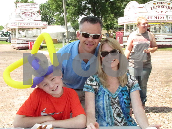 Griffin, Dan, and Angelia Buhr of Ames were visiting the Webster County Fair.