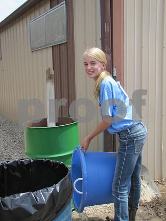 Jayden Muench doing chores between shows.