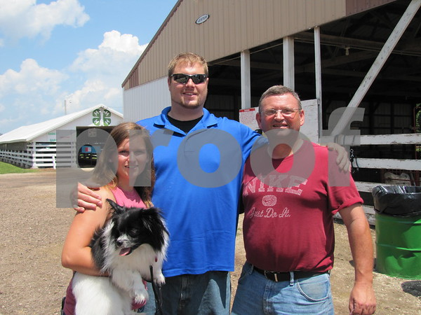 Rachel Pugh, Brandon Barkley, and Mark Pugh were checking out all the animals at the fair.