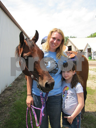 "Kierra Eldridge and her horse ""Shay"" with Chloe Speck."