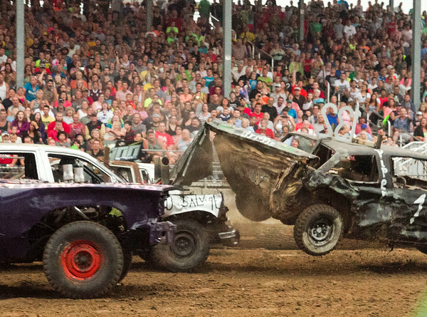SAM HOUSEHOLDER | THE GOSHEN NEWS A car gets airbourne after being struck by a competitor's car Saturday night during the demolition debry at the Elkhart County 4-H Fair.