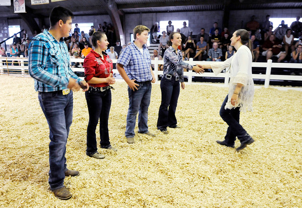 Don Knight   The Herald Bulletin<br /> Judge Lynsee Pullen from Walton Ind. announces Hannah Alcala's win in the Supreme Showmanship competition by shaking her hand at the 4-H Fairgrounds on Thursday. Other competitors from left are Kalib Mauck, Terra Weber and Miller Smith.