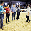 Don Knight | The Herald Bulletin<br /> Judge Lynsee Pullen from Walton Ind. announces Hannah Alcala's win in the Supreme Showmanship competition by shaking her hand at the 4-H Fairgrounds on Thursday. Other competitors from left are Kalib Mauck, Terra Weber and Miller Smith.