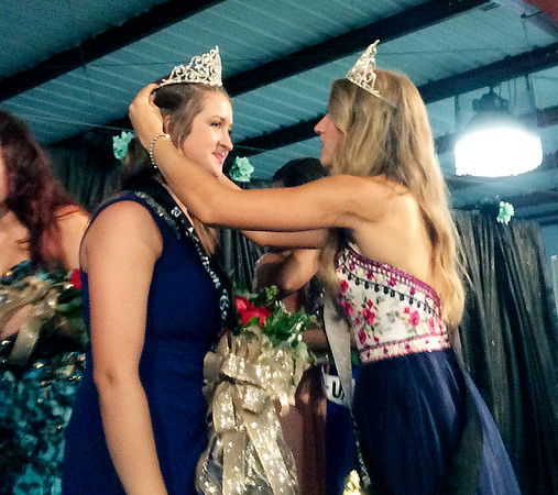 2016 Madison County 4-H Fair queen, Mackenzie Boone, right, adjusts the crown of her successor, 2017 Queen Marlee Hobbs.