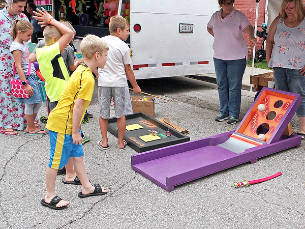 Mark Maynard | for The Herald Bulletin<br /> Drew Brooks of Lapel tries his hand at Skee Ball in the Ford Street United Methodist Church's booth at the Lapel Village Fair.