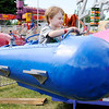 Don Knight | The Herald Bulletin<br /> Eiven Rominger, 5, rides in a rocket ship amusement at the Madison County 4-H Fair on Tuesday.