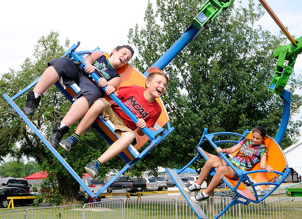 Don Knight | The Herald Bulletin<br /> From left, Jacob Ellis, Robert Seal and Faith Breese ride The Cobra at the Madison County 4-H Fair on Tuesday.