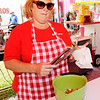 Don Knight | The Herald Bulletin<br /> Shannon Talmage prepares an order of funnel cake fries at Dev's Deep Fried Madness at the Madison County 4-H Fair on Tuesday.