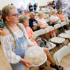 Don Knight | The Herald Bulletin<br /> Gwyn Key, 10, auctions her blue ribbon blue berry muffins during the Extension Homemakers Auction at the Madison County 4-H Fair on Tuesday.